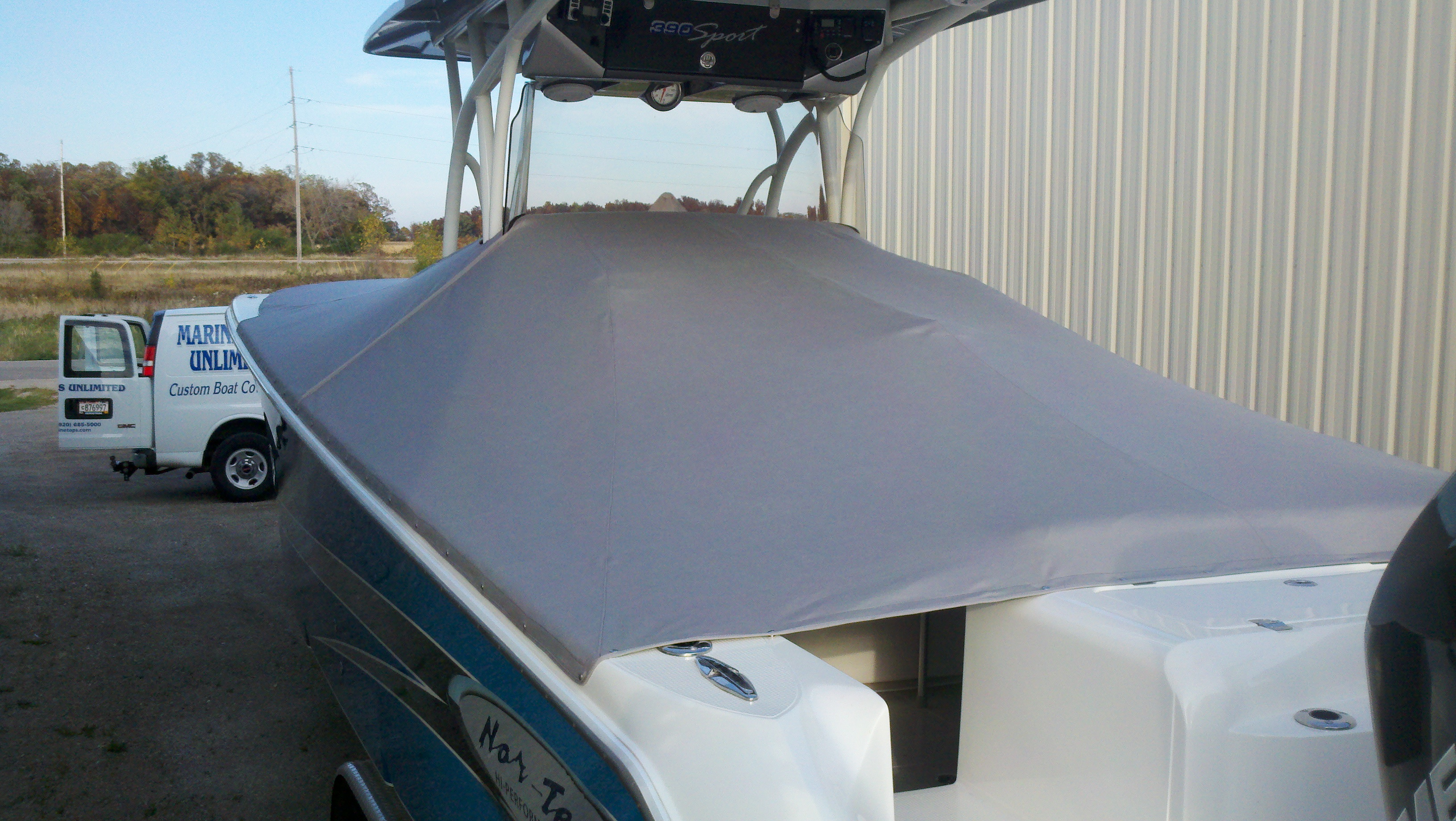 Custom Sunbrella Boat Cover: NorTech 2 piece full cockpit cover with zipper cutouts for T-top