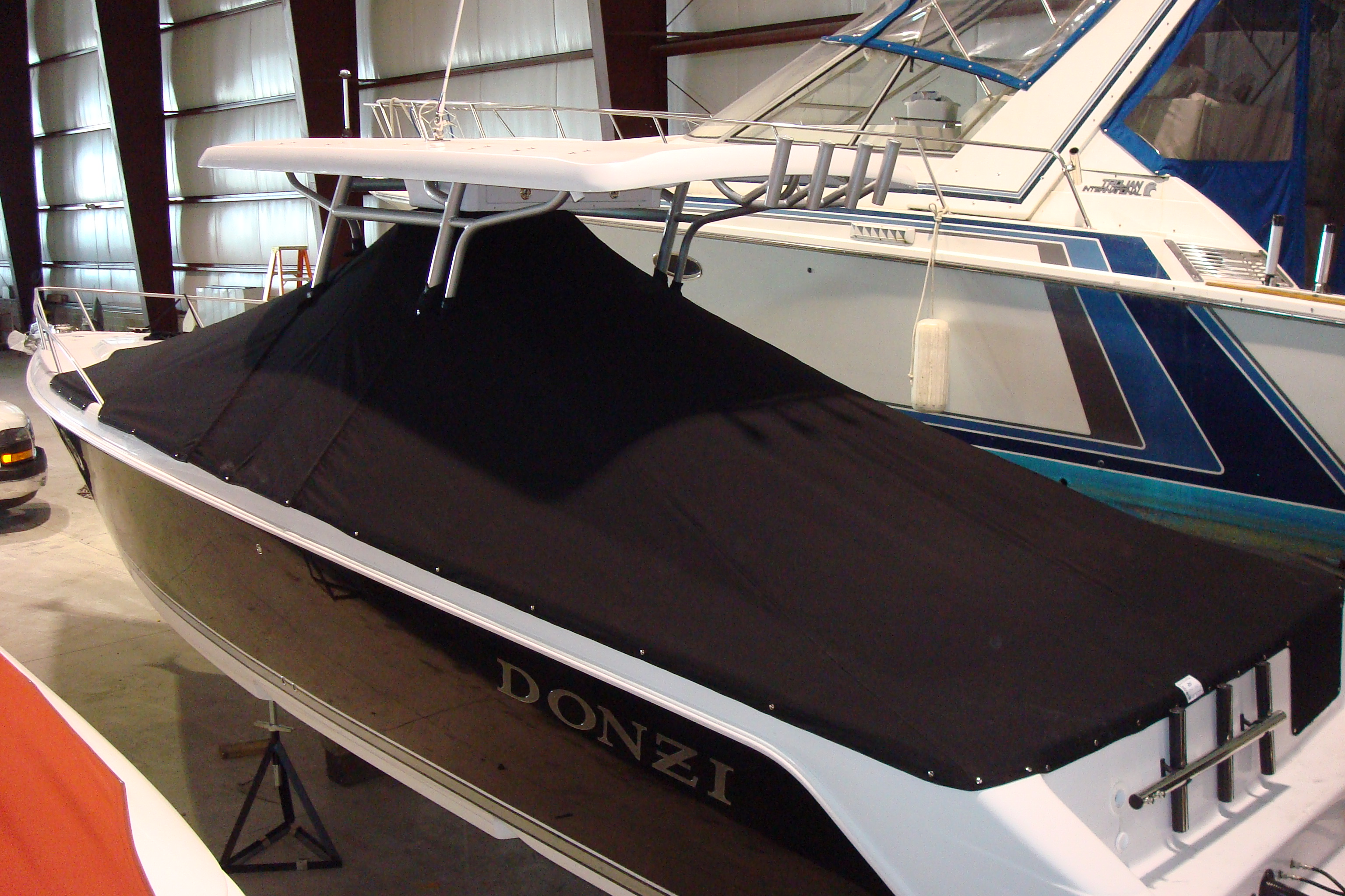 Custom Sunbrella Boat Cover: Donzi full snap on cockpit cover with zipper cutouts for T-top