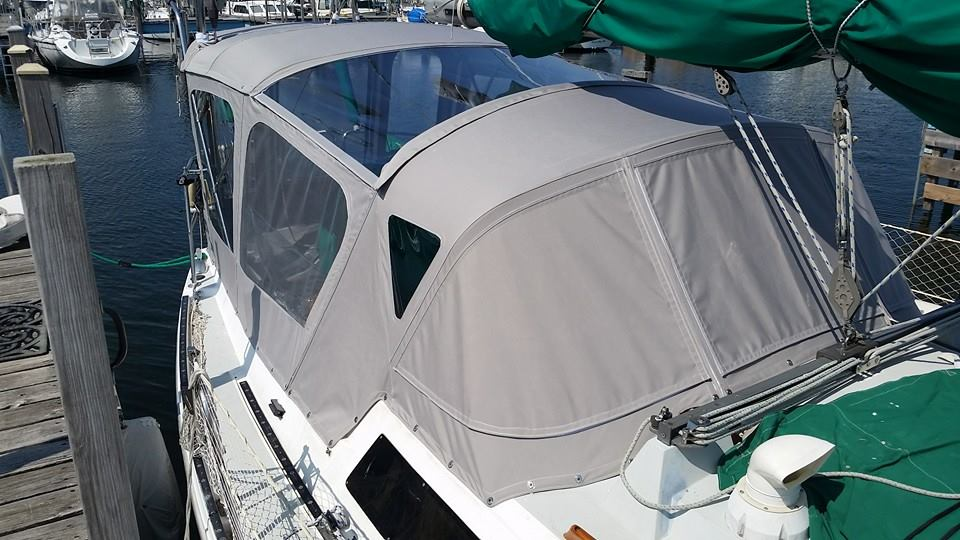 Custom Sail Boat Dodgers and Enclosures: Standard dodger made with Strataglass including rear bimini top and connector with full enclosure