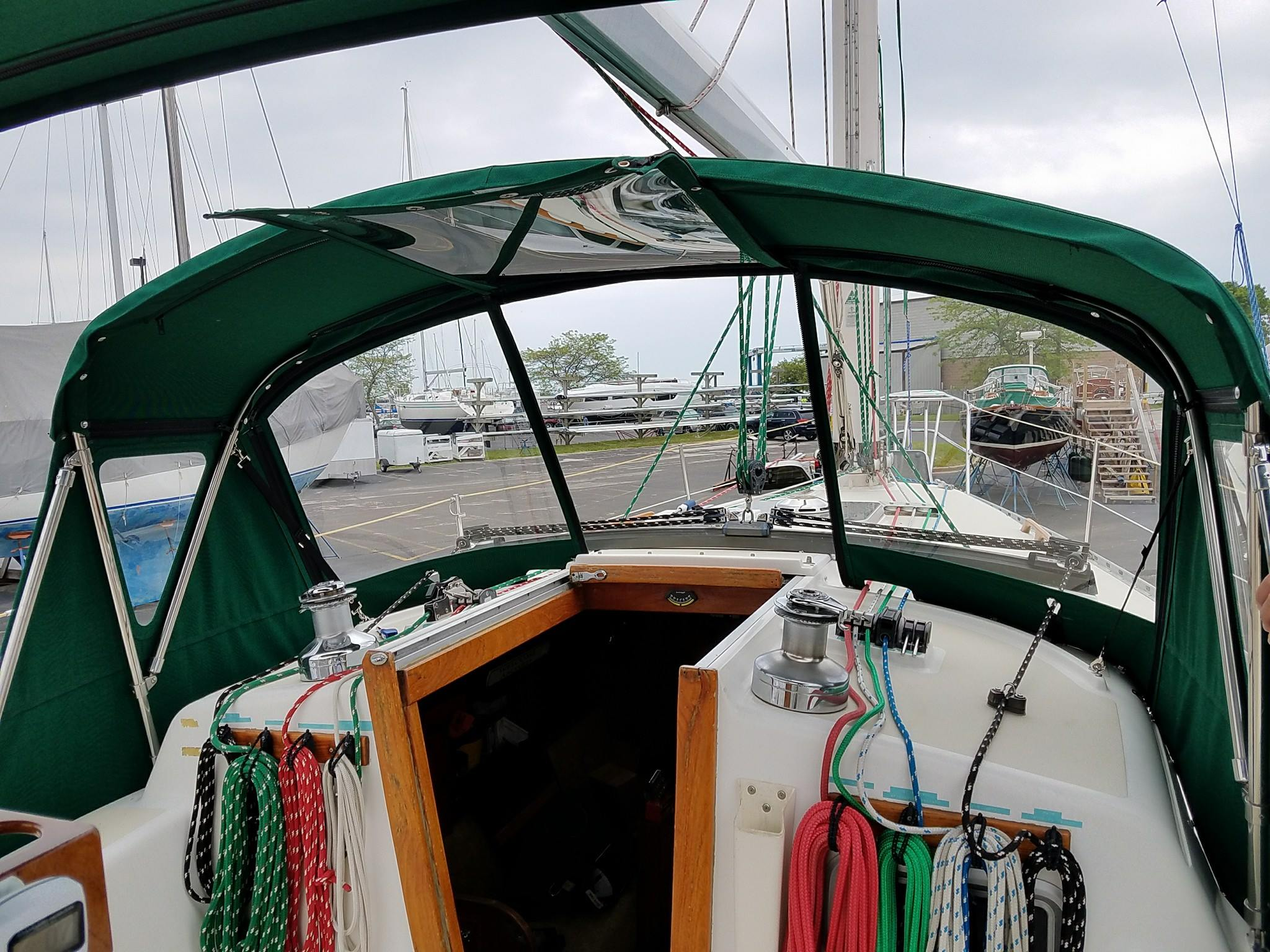 Custom Sail Boat Dodgers and Enclosures:California dodger made with .060 Makrolon AR2 polycarbonate rigid widows and bimini top