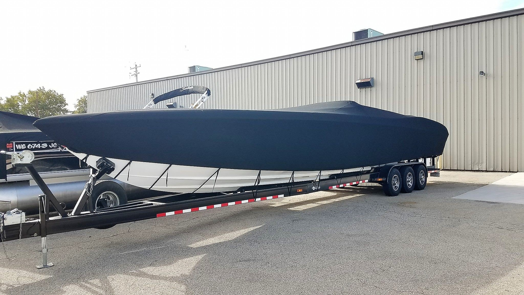 Custom Sunbrella Boat Cover: Outerlimits 42' Legacy mooring cover with custom drops and trailering straps