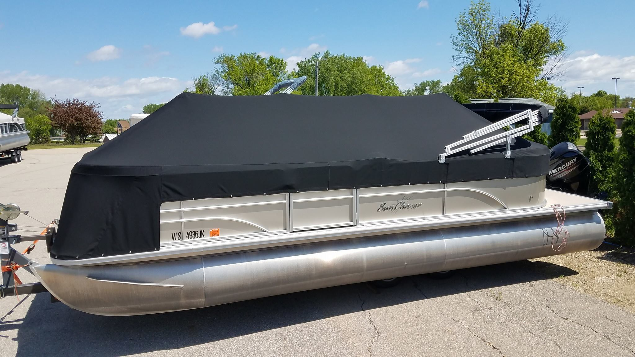 Custom Sunbrella Boat Cover: Pontoon playpen cover with front extension and cutouts and velcro flaps for bimini top frame