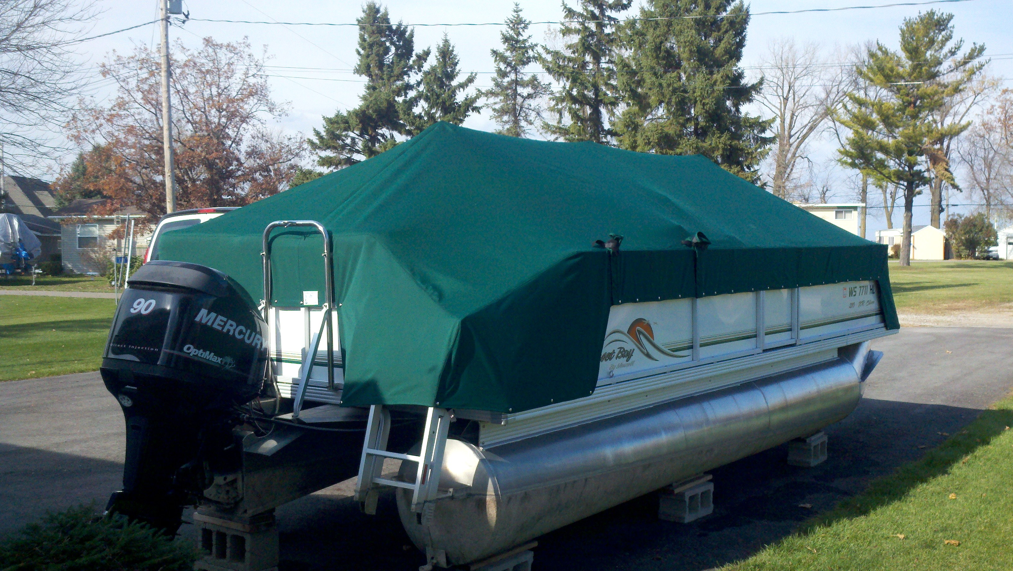 Custom Sunbrella Pontoon Cover: Playpen cover with front and rear extension and cutouts with velcro flaps and sleeves for bimini