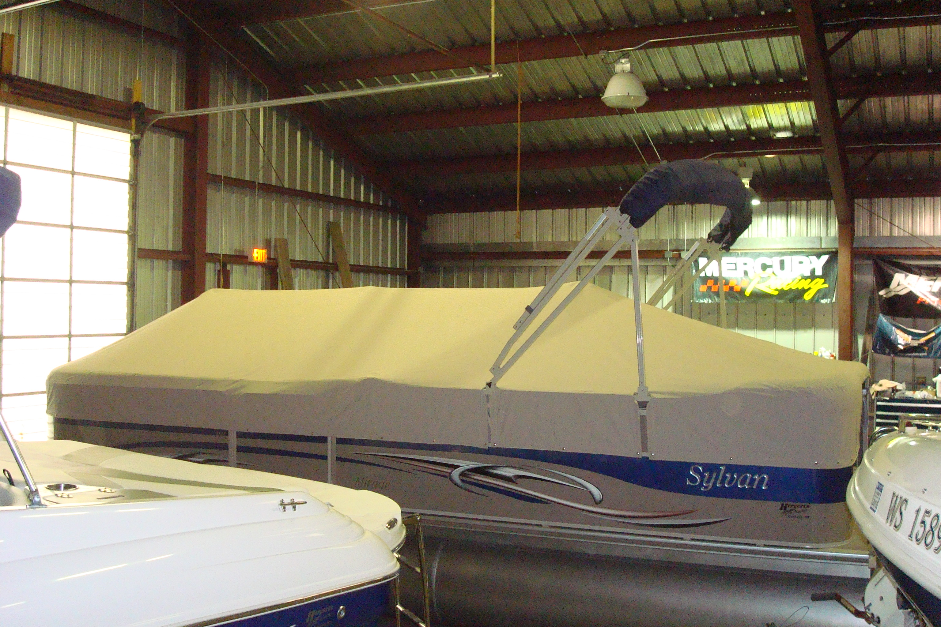 Custom Sunbrella Pontoon Cover: Playpen cover with cutouts for bimini frame