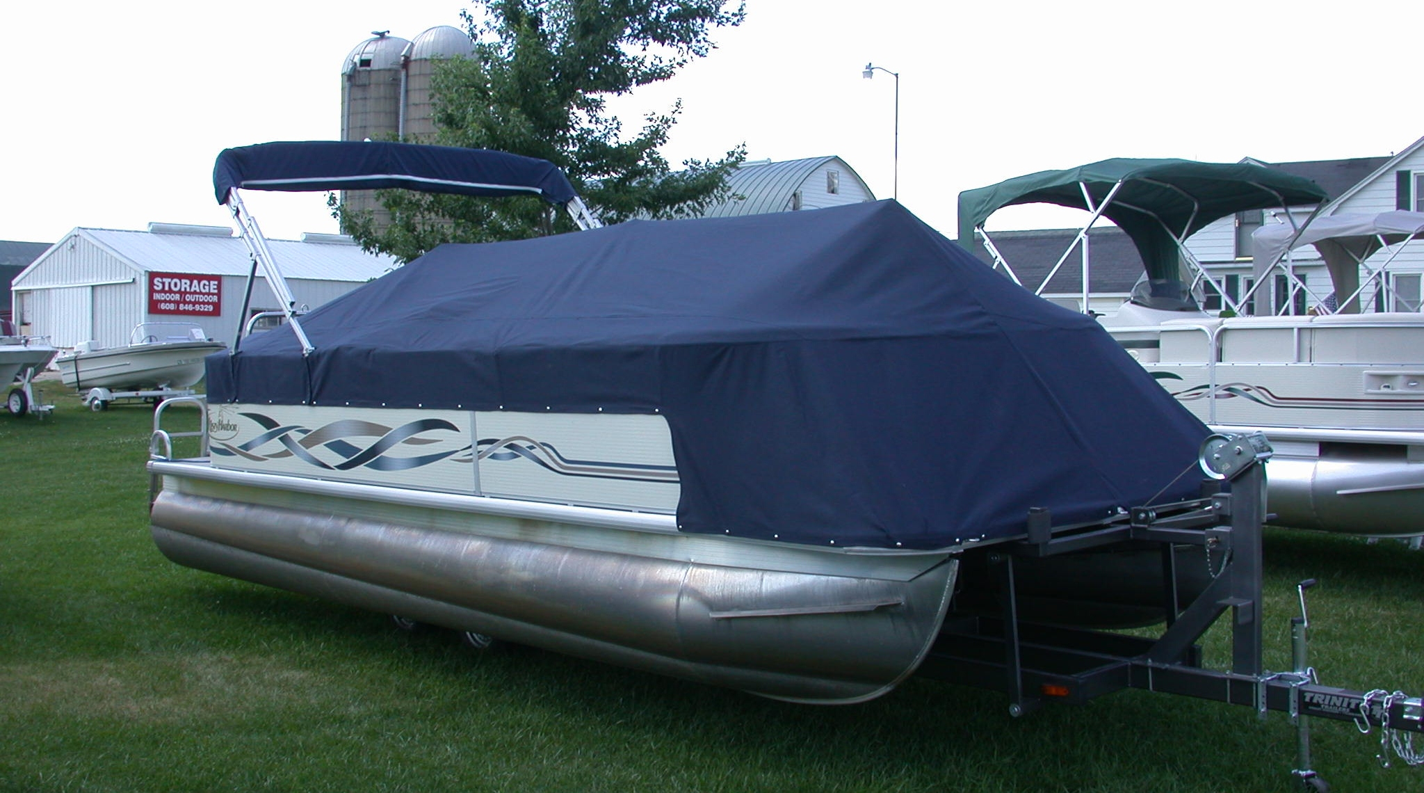 Custom Sunbrella Pontoon Cover: Playpen cover with front extension and cutouts with velcro flaps for bimini