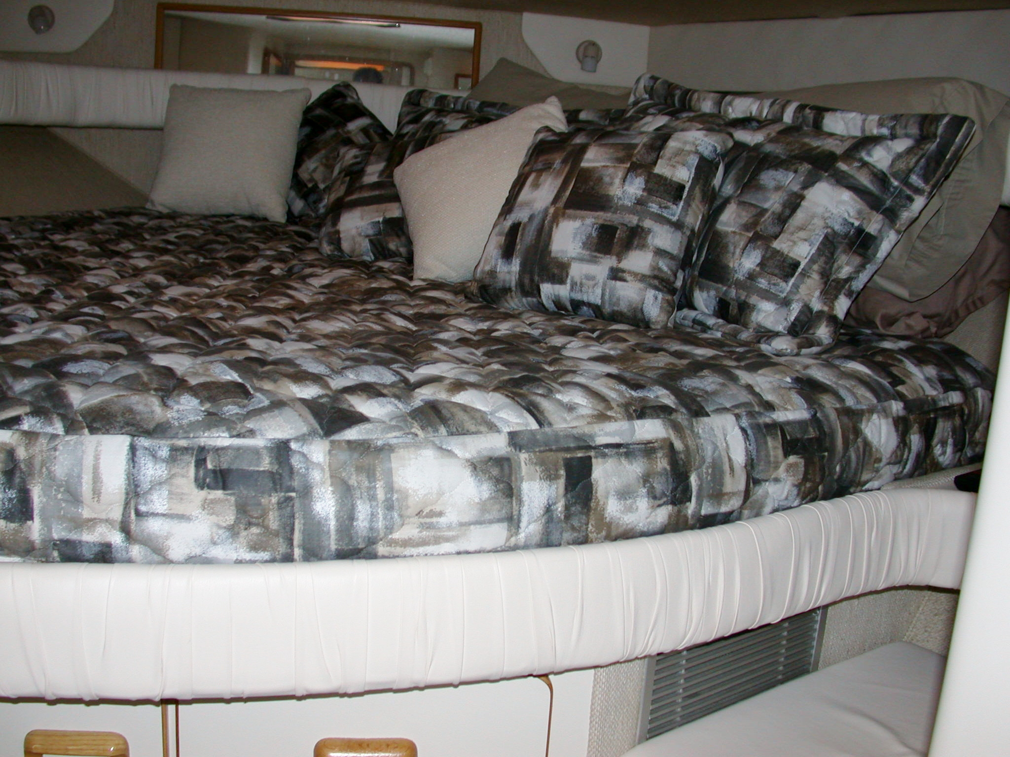 Custom Marine Interiors, Upholstery, and Carpeting: 440 Sea Ray Sundancer forward cabin with custom bedspread and pillow shams