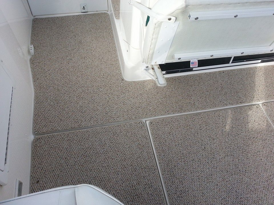 Custom Marine Interiors, Upholstery, and Carpeting: New carpet mats in Wellcraft Martinique express cruiser with seperate pieces for engine hatch