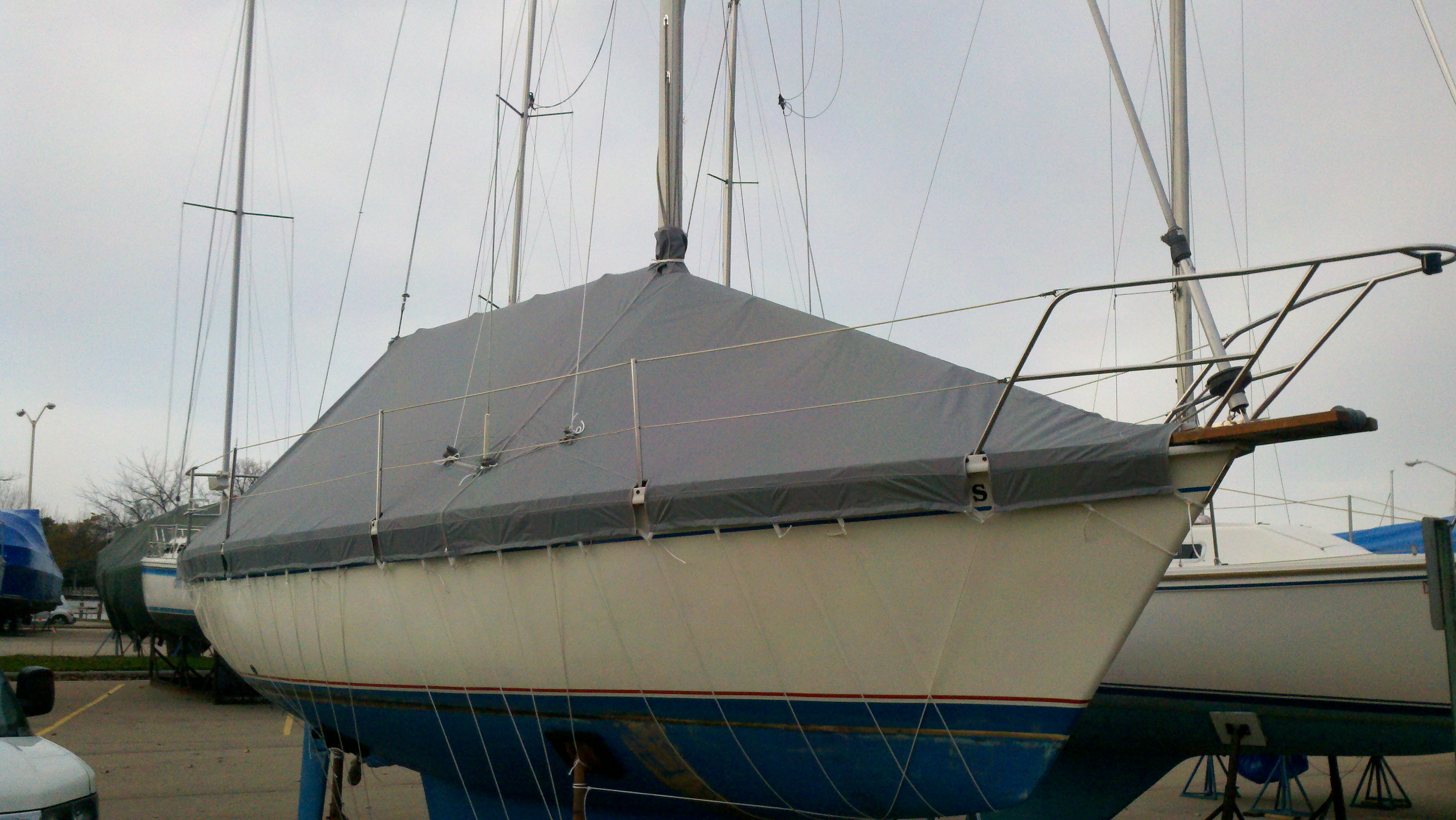 Custom Marine/Boat/Yacht Winter Cover: 2 piece sail boat winter cover over the boom with cutouts